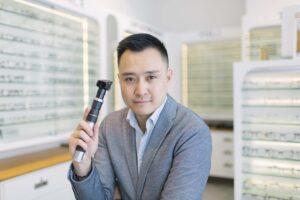 Male Optometrist holding a scope