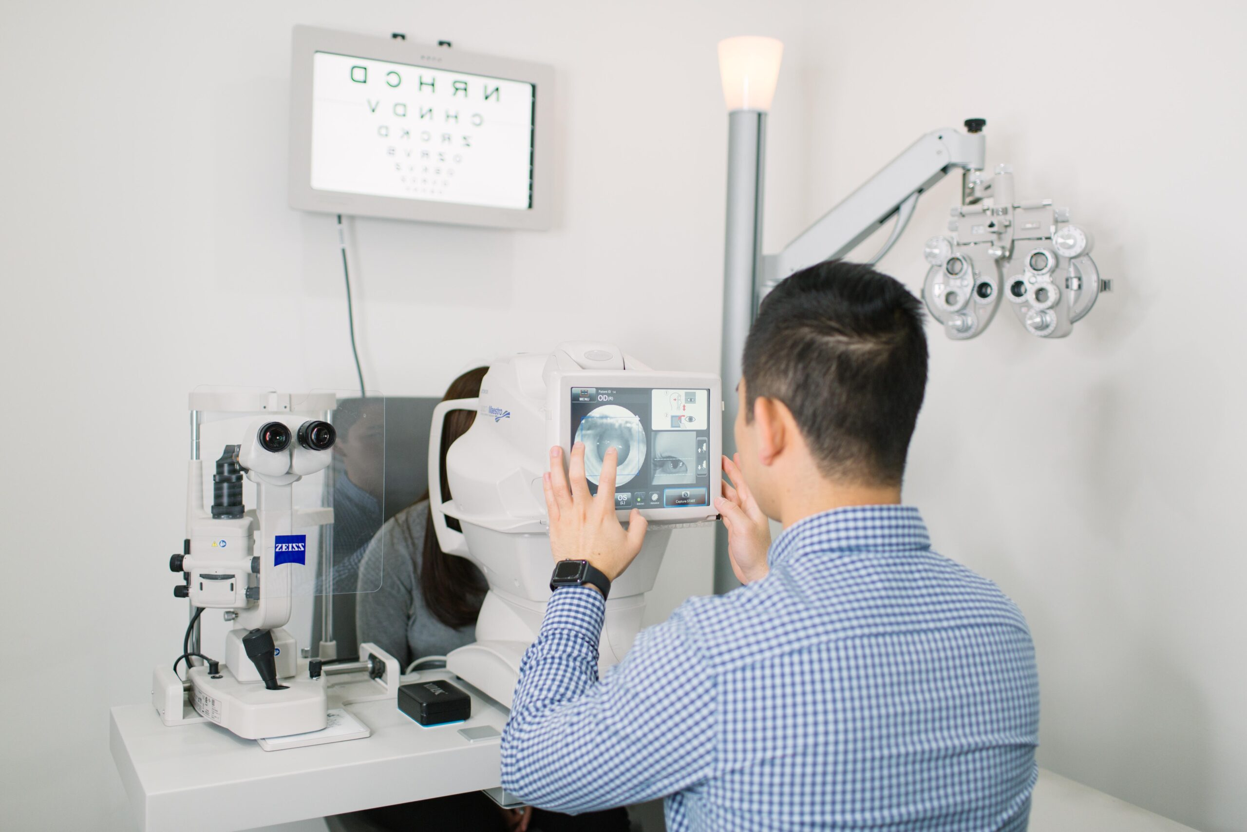 An optometrist doing a scan on a patient