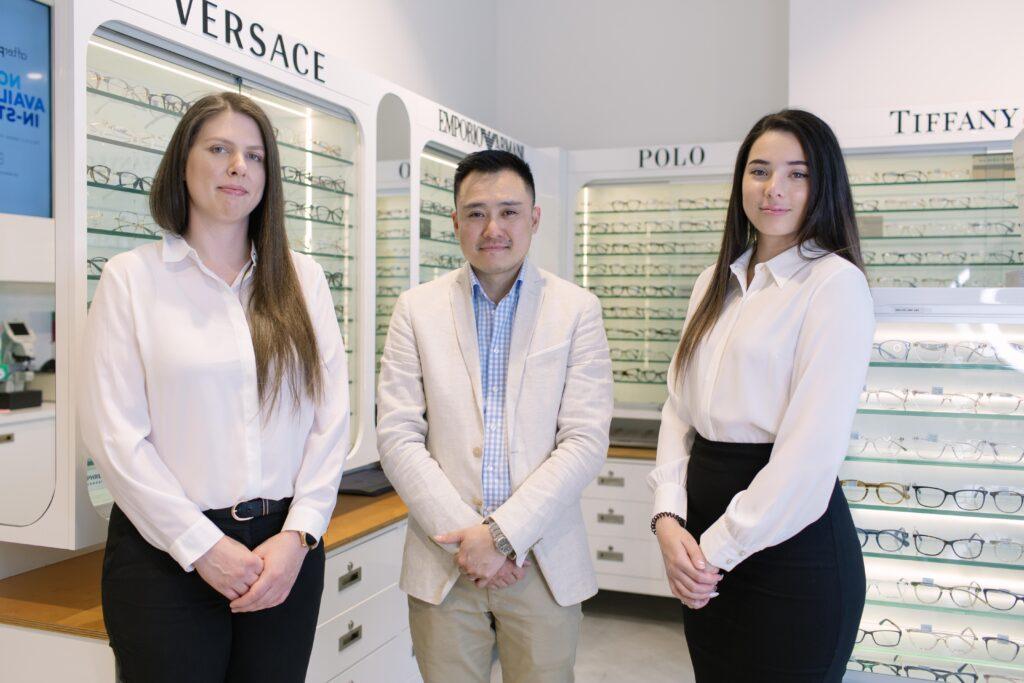 Staff photo of an optometrist and 2 lady staff