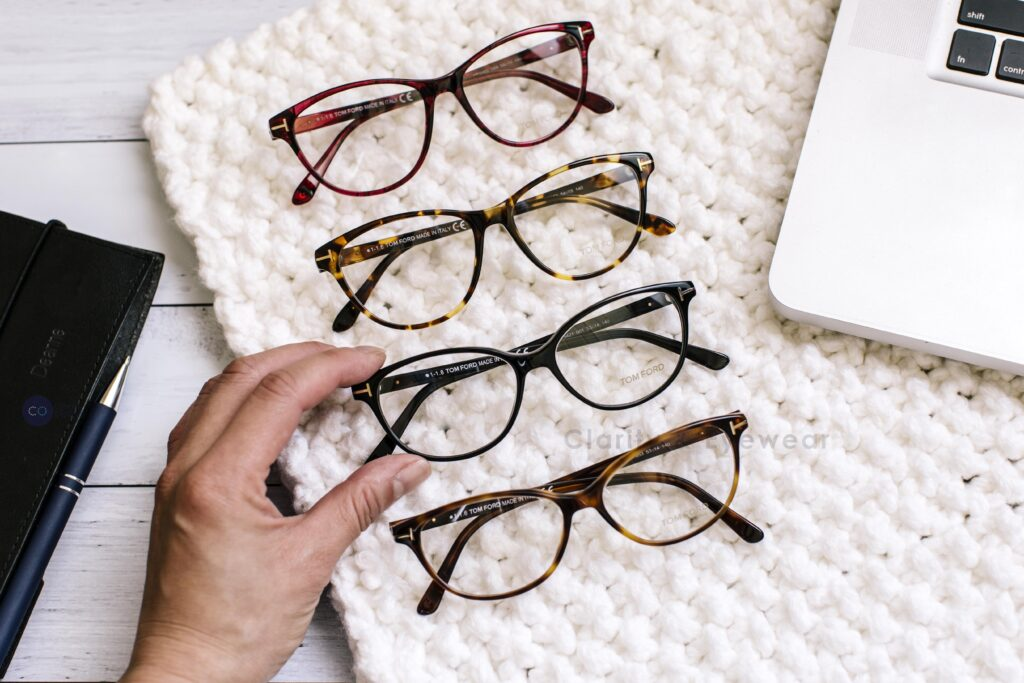 4 different type of optical glasses next to a computer