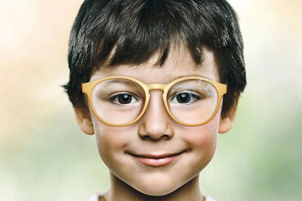 A child wearing MiyoSmart glasses