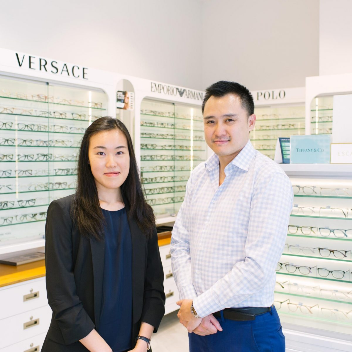 Dr Peter Le and Sylvia Chau team photo together standing in an optical shop.